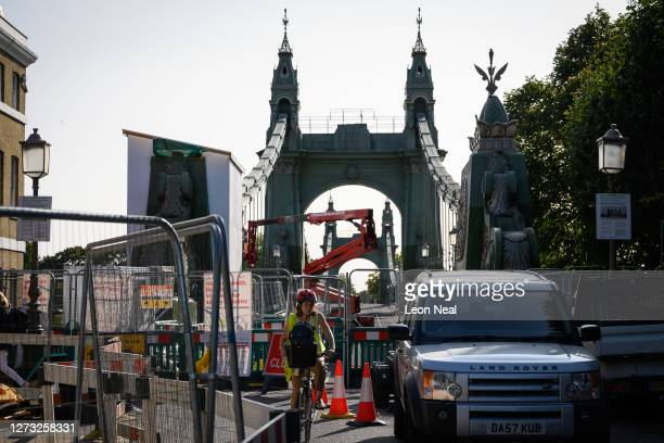 A cyclist negotiates the closed paths and alleyways around Hammersmith Bridge which has now been closed for nearly a year and a half due to safety...
