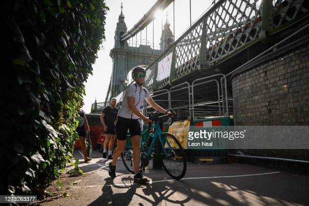 Cyclist negotiates the closed paths and alleyways around Hammersmith Bridge which has now been closed for nearly a year and a half due to safety...