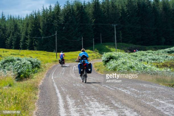 Cyclist on a rural road in Scotland