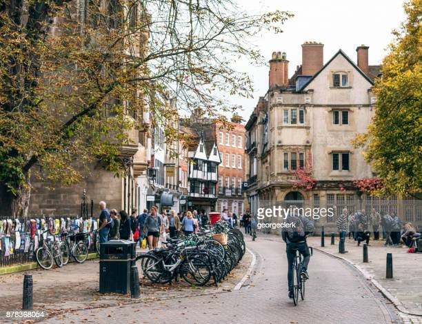 cyclist on a street in cambridge, england - cambridge stock pictures, royalty-free photos & images