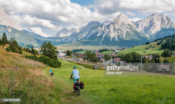 Cyclist on bike tour with mountain bike, on the cycle path Via Claudia Augusta, in the back Ehrwalder Sonnenspitze, crossing the Alps, mountain landscape, Alps, Ehrwald Basin, near Ehrwald, Tyrol, Austria