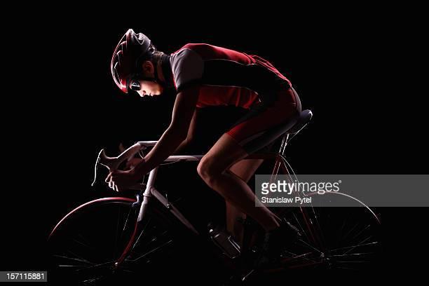 cyclist on black background - passie stockfoto's en -beelden
