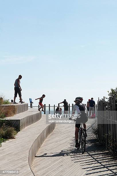 cyclist on boardwalk in sète, france - herault stock pictures, royalty-free photos & images