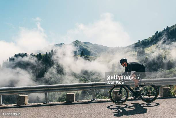 cyclist on col de la colombière - racing bicycle stock pictures, royalty-free photos & images