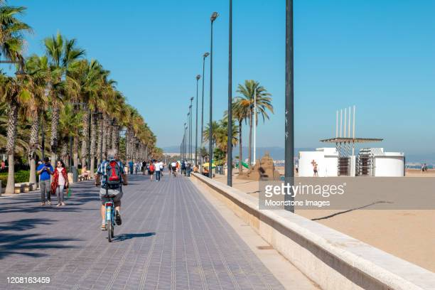 cyclist on el cabanyal in valencia, spain - boulevard stock pictures, royalty-free photos & images
