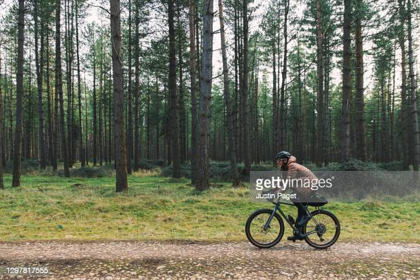 cyclist on forest track - riding stock pictures, royalty-free photos & images