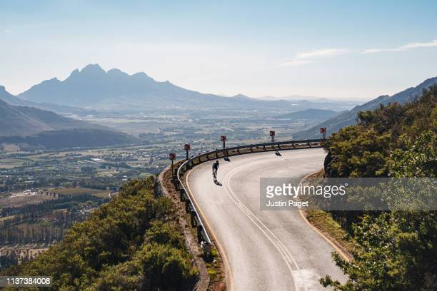 cyclist on franschhoek pass - south africa stock pictures, royalty-free photos & images