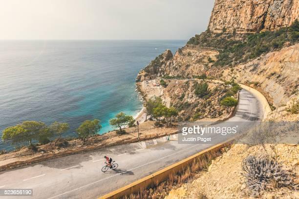 Cyclist on Killer Beach Climb, Cumbre del Sol, Spain