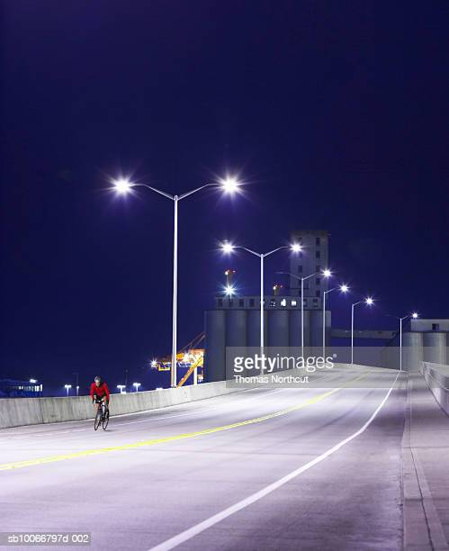Cyclist on road at night