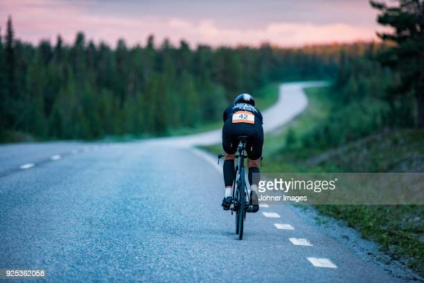 cyclist on road - triathlon stock pictures, royalty-free photos & images