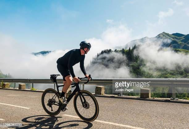 cyclist on the col de la colombiere in the french alps - cycling stock pictures, royalty-free photos & images
