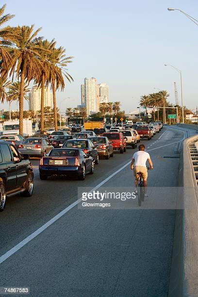 Cyclist on the road, Miami, Florida, USA