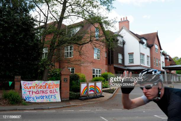 A cyclist passes a banner thanking all key workers outside the Sunrise Senior Living care home in Esher southwest of London on May 2 2020 as life in...