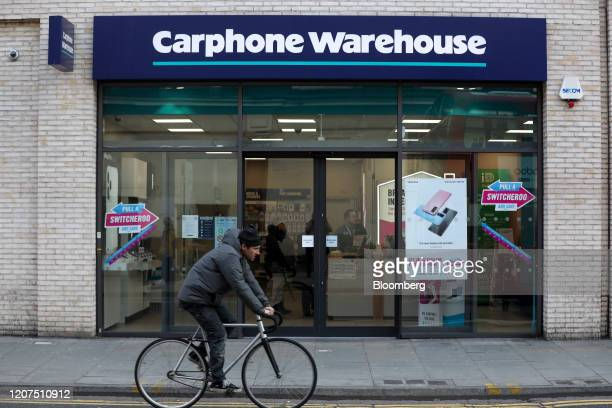 A cyclist passes a branch of Carphone Warehouse operated by Dixons Carphone Plc in London UK on Tuesday March 17 2020 Dixons plans to close 531...
