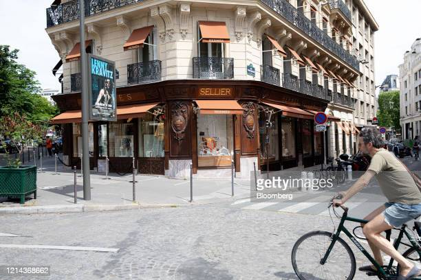 A cyclist passes a Hermes luxury goods boutique on George V Avenue in Paris France on Thursday May 21 2020 Frencheconomic activityshrank at a...