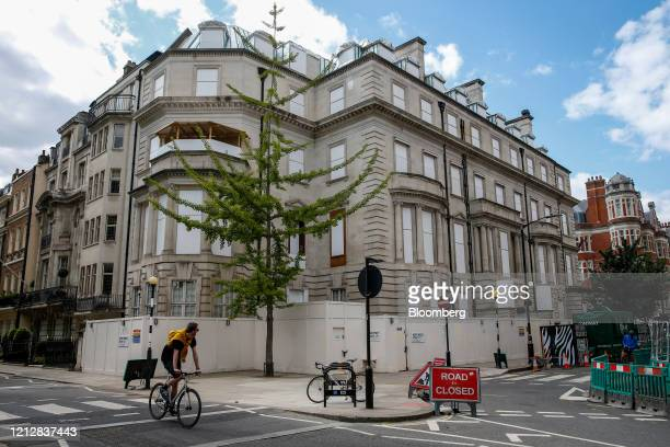 Cyclist passes a hotel being developed at 22 Grosvenor Square in the Mayfair district of London, U.K., on Tuesday, May 12, 2020. The pandemic has...