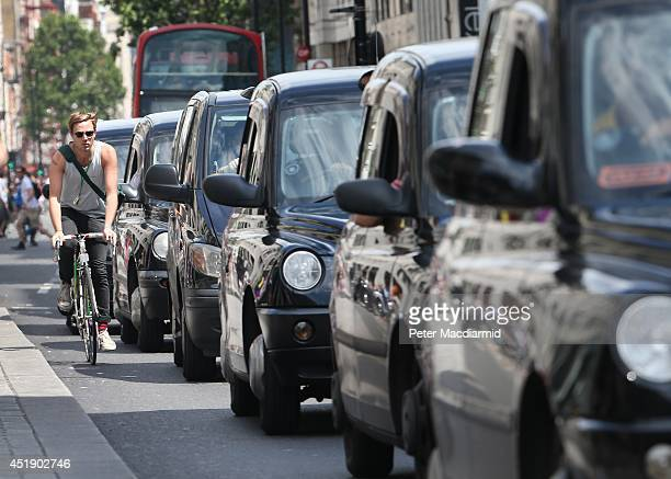A cyclist passes a line of taxis in Oxford Street on July 9 2014 in London England Researchers from King's College London have found that...