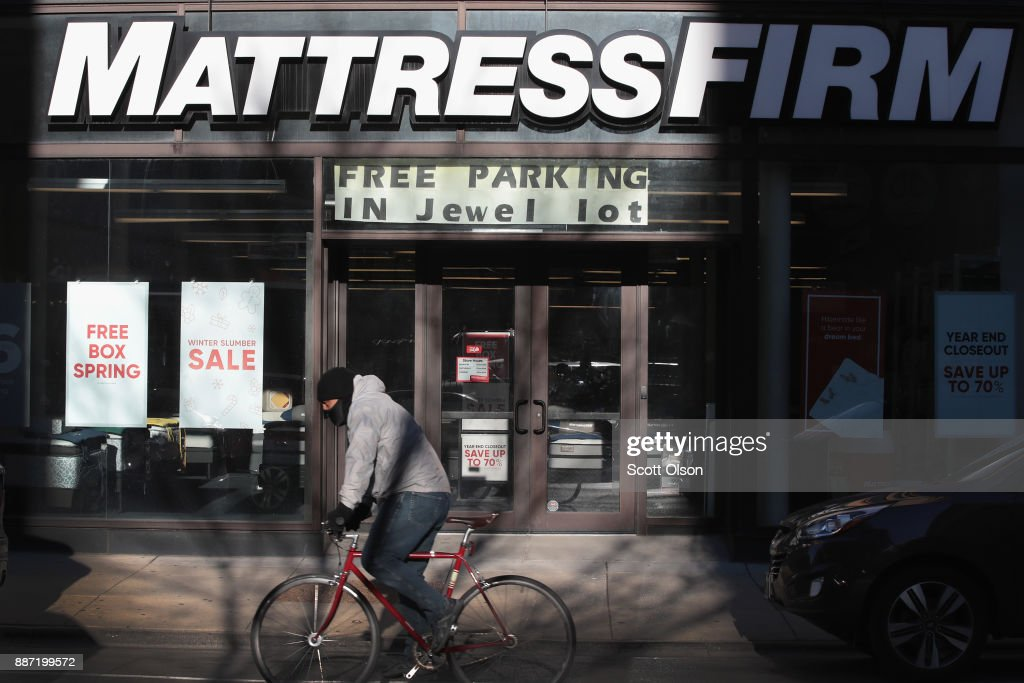 A cyclist passes a Mattress Firm store on December 6, 2017 in Chicago, Illinois. Steinhoff International Holdings N.V., which is the parent company of Mattress Firm, saw its stock value plummet more than 60 percent today after the resignation of CEO Markus Jooste and an announcement from the company that it was launching an investigation into accounting irregularities.