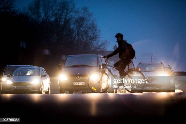 A cyclist passes a street on January 10 2018 in Berlin Germany