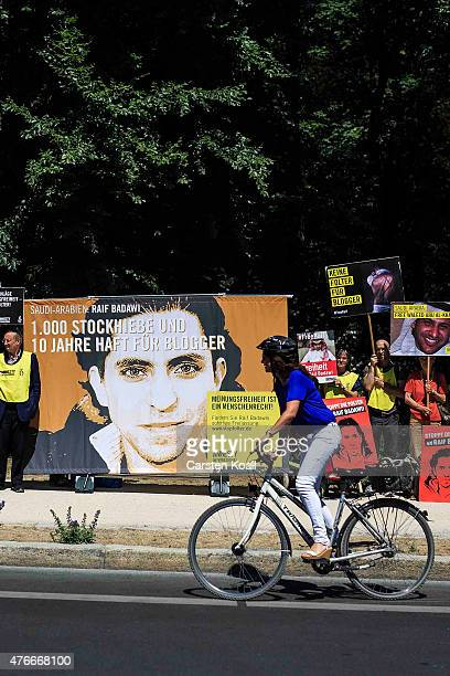 A cyclist passes as activists demonstrate outside the Saudi Arabian Embassy against the recent Saudi court ruling that upheld a previous verdict of...