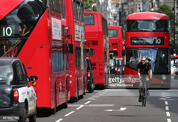 Cyclist passes buses and taxis in Oxford Street on July 9, 2014 in London, England. Researchers from King's College London have found that...
