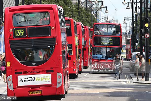 A cyclist passes buses in Oxford Street on July 9 2014 in London England Researchers from King's College London have found that concentrations of...