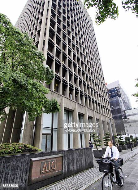 A cyclist passes by the building of US insurance giant American International Group in Tokyo on May 8 2009 AIG is close to reaching a deal to sell...