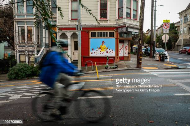 Cyclist passes in front of a mural painted by San Francisco muralist Nicole Hayden, of poet Amanda Gorman on Page Street on Thursday, Jan. 28, 2021...