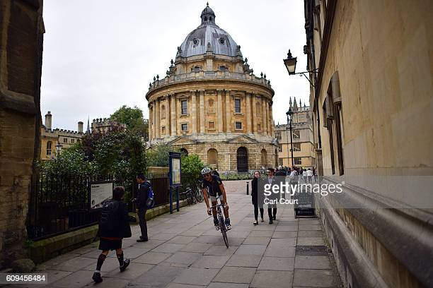A cyclist passes Radcliffe Camera on September 20 2016 in Oxford England Oxford University has taken number one position in the 20162017 world...