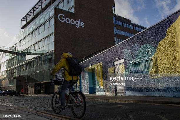 Cyclist passes the European headquarters building of Google Inc. In Dublin, Ireland, on Monday, Jan. 6, 2020. Ireland issued a record number...