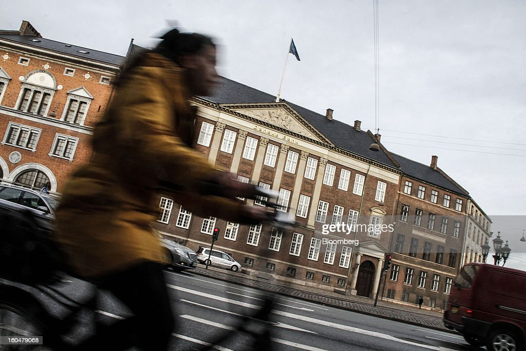 A cyclist passes the headquarters of Danske Bank A/S, center, in Copenhagen, Denmark, on Friday, Feb. 1, 2013. Danish regional banks are struggling to emerge from a burst property bubble that's forced the government resolution agency to take over a dozen lenders after losses on commercial and agricultural loans wiped out capital. Photographer: Freya Ingrid Morales/Bloomberg via Getty Images