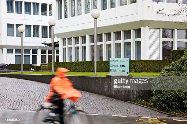 Cyclist passes the headquarters of Glencore International Plc in Baar, Switzerland, on Monday, March 19, 2012. Glencore International Plc Chief...