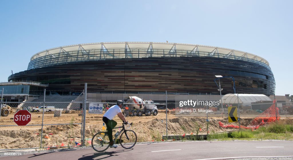 A cyclist passes the new Perth Stadium on March 17, 2017 in Perth, Australia. The WA Labor Party announced plans to sell off the naming rights of Perth Stadium and Perth Arena in order to boost the State's budget. The new stadium is currently under construction in the Perth suburb of Burswood.