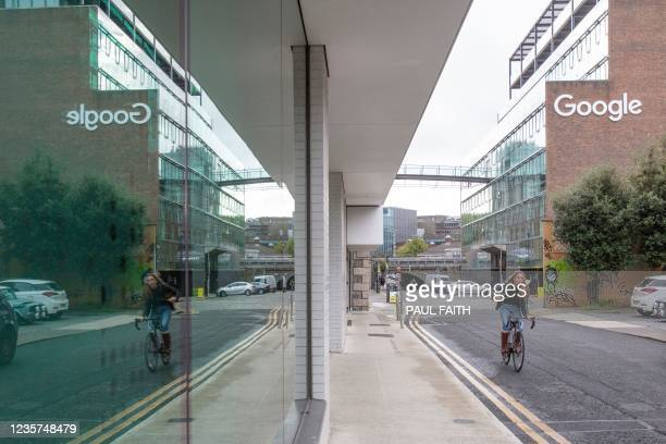 Cyclist passes the offices of Google in the business and financial sector of Dublin City centre on October 7, 2021. - The government of Ireland, one...