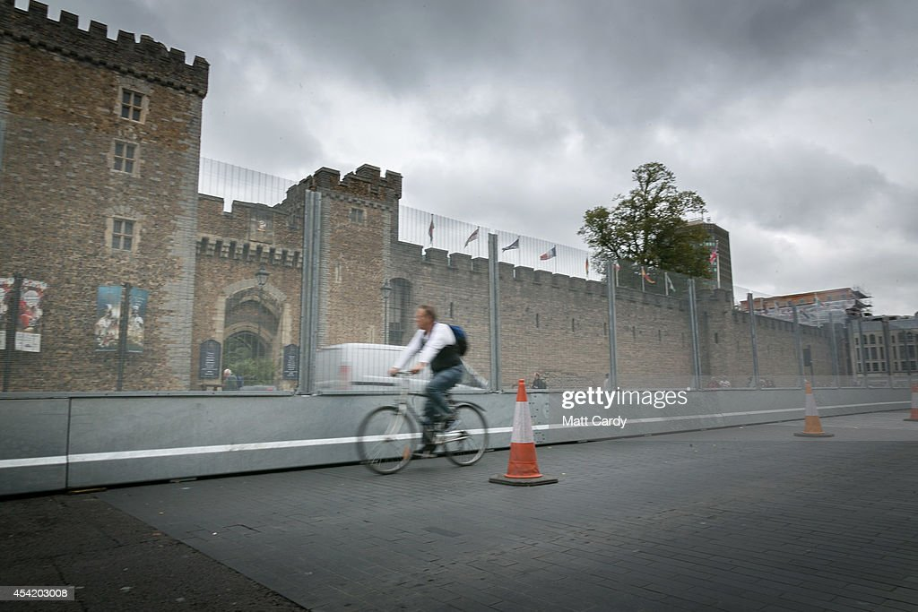 A cyclist passes the security fence that has been erected in front of Cardiff Castle ahead of the NATO summit that is being held in South Wales next week on August 26, 2014 in Cardiff, Wales. The barriers have been erected in the Welsh capital as a security measure as preparations for the international conference continue at the Celtic Manor Resort in Newport.