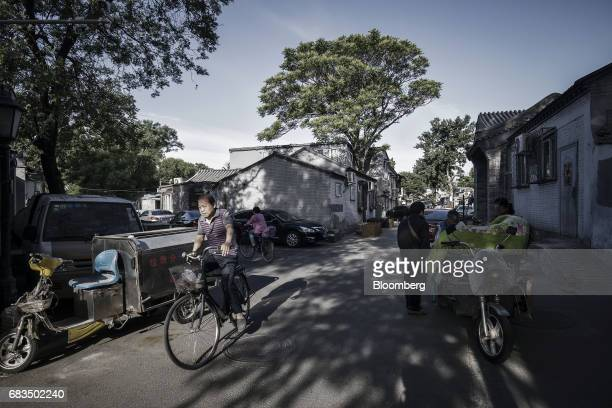 A cyclist passes through a traditional hutong neighborhood in Beijing China on Sunday May 14 2017 hotographer Qilai Shen/Bloomberg via Getty Images