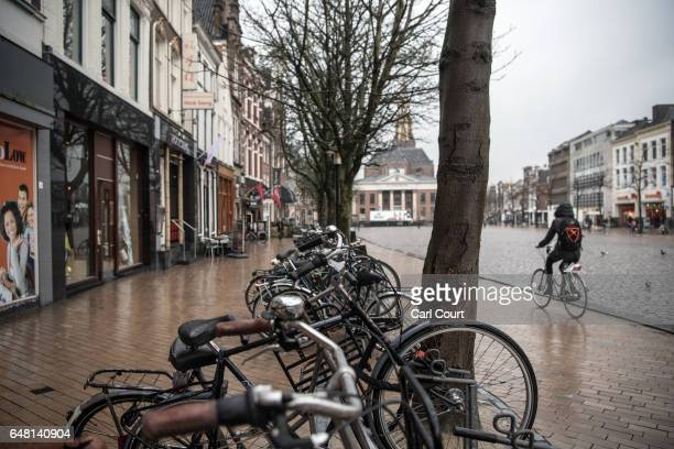 A cyclist passes through the town square on February 23 2017 in Groningen Netherlands The Dutch will vote in parliamentary elections on March 15 in a...