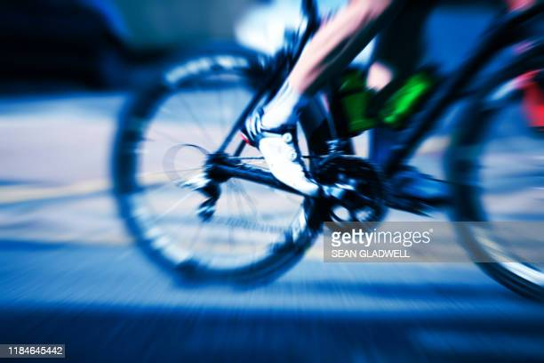 cyclist pedal motion - road race stock pictures, royalty-free photos & images