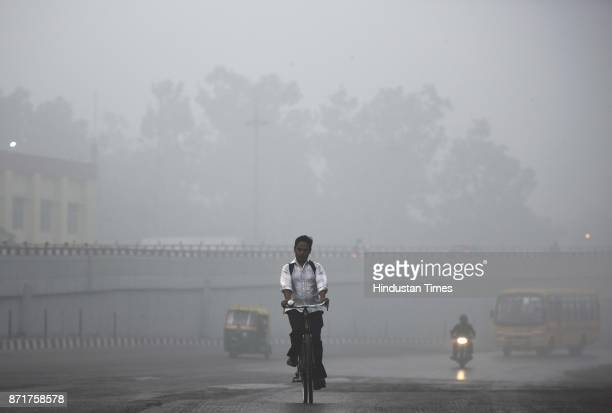 A cyclist pedals through heavy smog on November 8 2017 in New Delhi India Delhi was enveloped in a thick blanket of haze for the second consecutive...