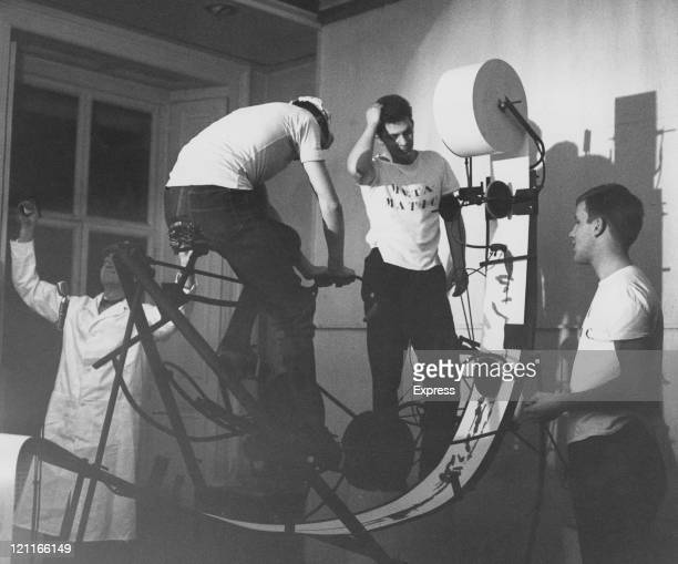 A cyclist pedals to move a roll of paper through a mechanical painting device as part of a lecture at the ICA called 'Metamatic' by Swiss artist Jean...
