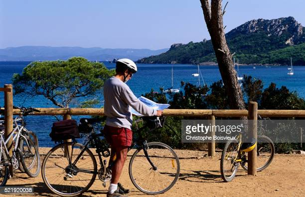 Cyclist Reading his Map