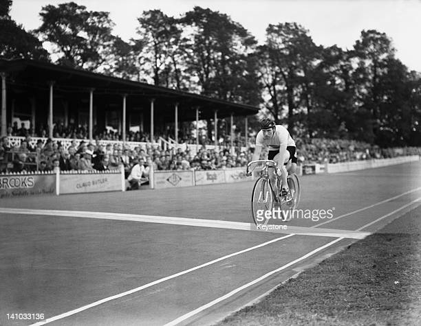 Cyclist Reg Harris of Great Britain wins heat eight of round two in the Men's Sprint at Herne Hill Velodrome during the Olympic Games London 7th...