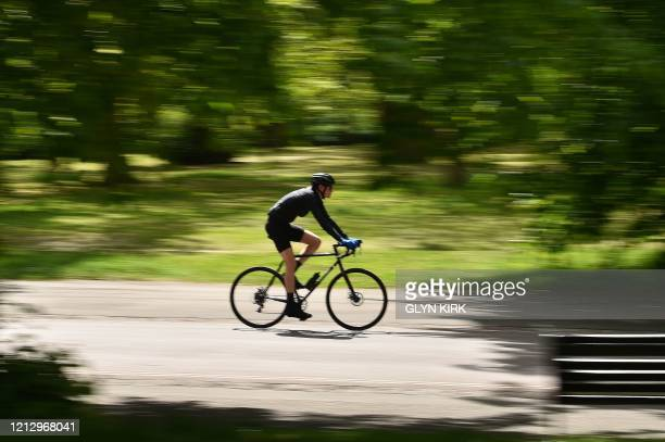 Cyclist rides a bike through Greenwich park, south east London on May 14 following an easing of the novel coronavirus COVID-19 lockdown restrictions....