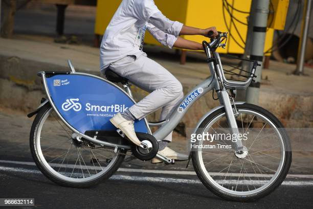 A cyclist rides a smart bike as he participates in a cycle rally on the occasion of World Bicycle Day 2018 after Vice President Venkaiah Naidu...