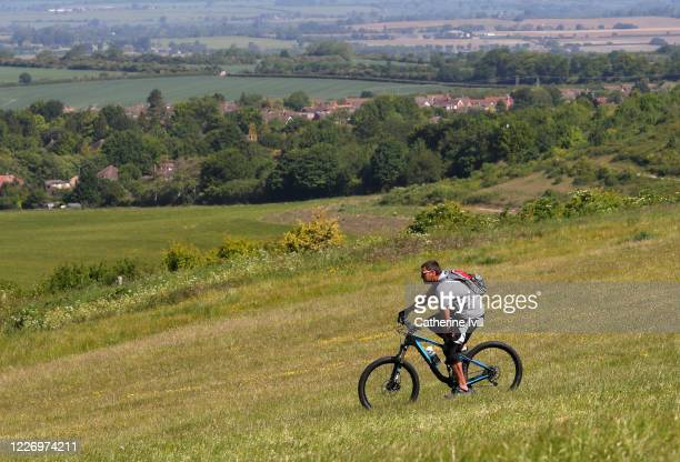 Cyclist rides across the Chiltern Hills on May 25, 2020 in Dunstable Downs, England. The British government has started easing the lockdown it...