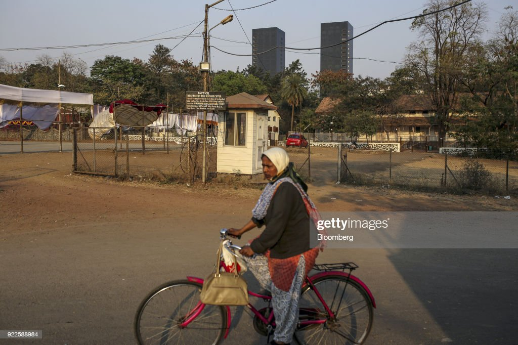 A cyclist rides along a road as the Trump Towers Pune complex, developed by Panchshil Corp Park Pvt., stands in the distance in Pune, Maharashtra, India, on Wednesday, Feb. 21, 2018. Donald Trump Jr. is slated to speak on foreign policy at an event in New Delhi where Indian Prime MinisterNarendra Modiis also scheduled to speak. Photographer: Dhiraj Singh/Bloomberg via Getty Images