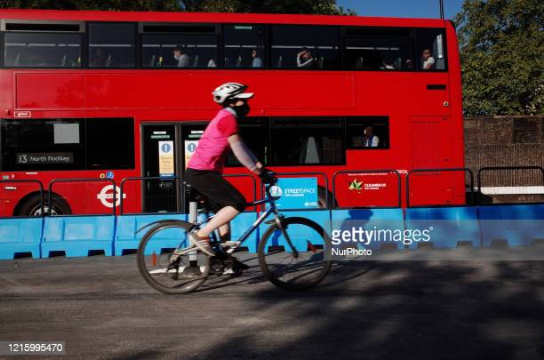 Cyclist rides along a section of the Mayor of London's 'Streetspace' scheme, designed to expand capacity for pedestrians and cyclists on certain...