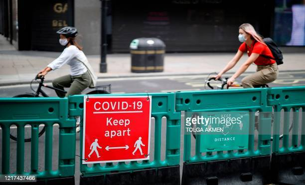 A cyclist rides along on Oxford Street where barriers have been installed to widen he pavement to enable social distancing due to the COVID19...