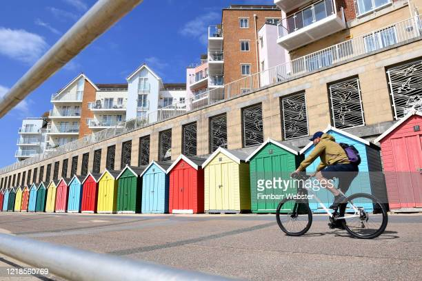 Cyclist rides along the promenade of Boscombe beach on April 13, 2020 in Bournemouth, United Kingdom. The Coronavirus pandemic has spread to many...