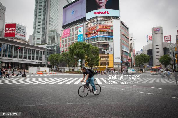 Cyclist rides along the streets during the lifting of the state of emergency. Japan has lifted a state of emergency imposed due to the coronavirus in...